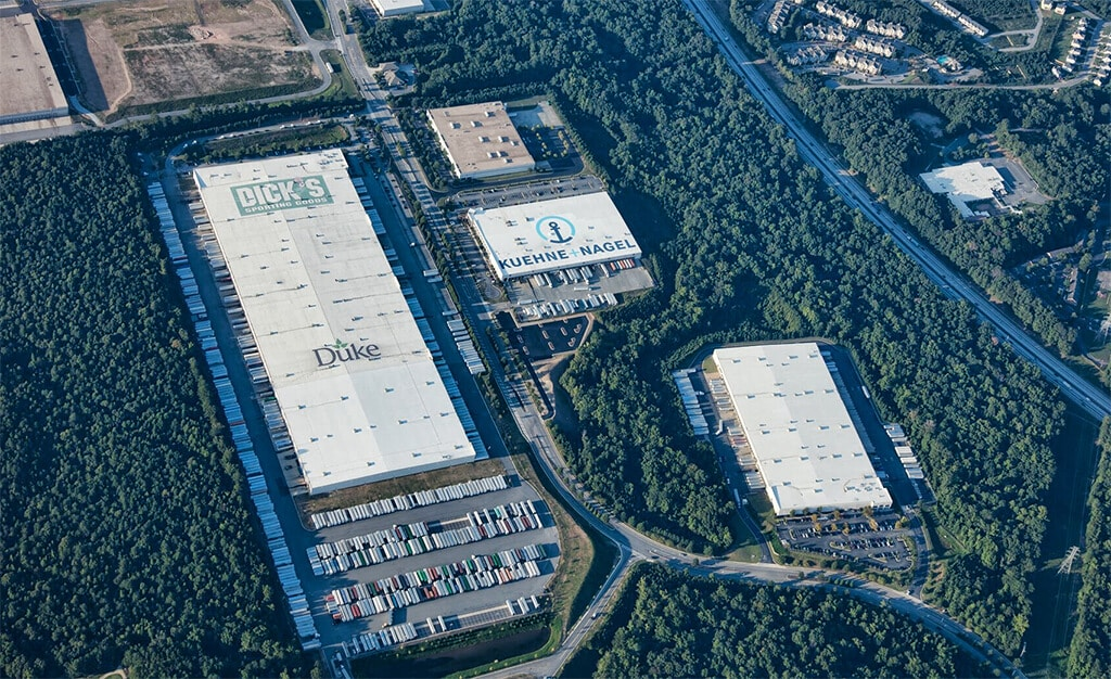 Aerial shot of Roof Logos for Dick's Sporting Goods, Duke Realty and Kuehne + Nagel in close proximity to one another
