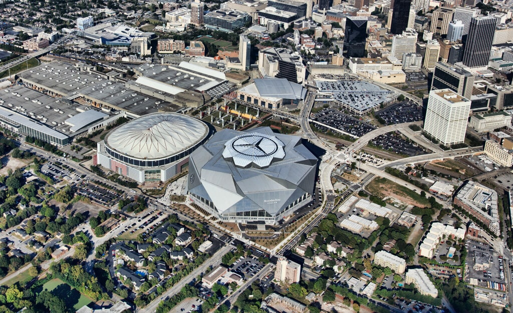 Aerial shot of Mercedes-Benz stadium in Atlanta, Georgia with Mercedes-Benz logo featured on skylight, applied by Roof Logos